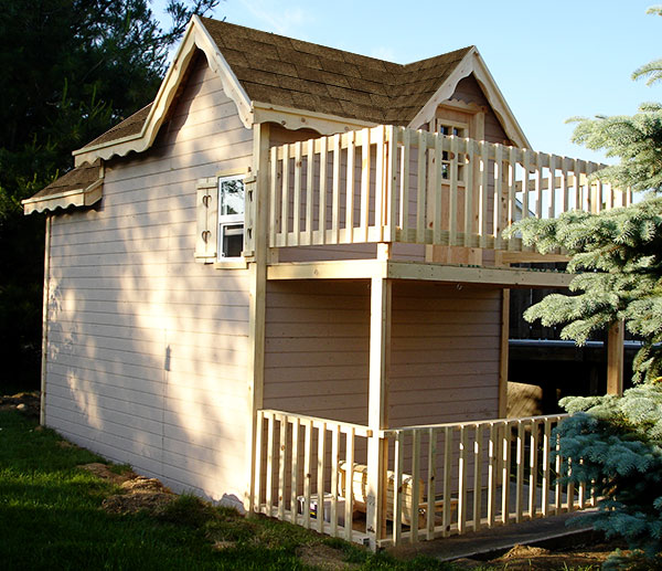 image of playhouse with deck