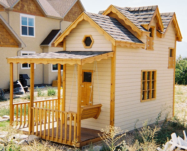 wrap around porch with swing for playhouse