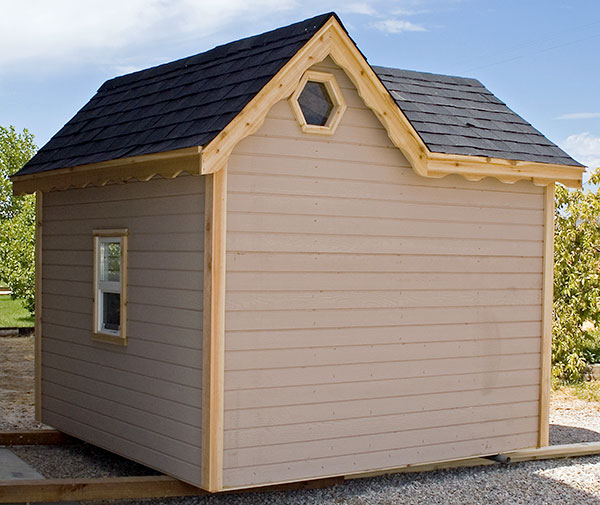 Image of back side of outdoor playhouse