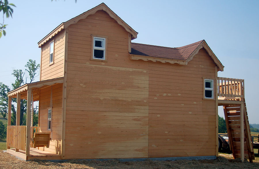 Image of backside of wood playhouse